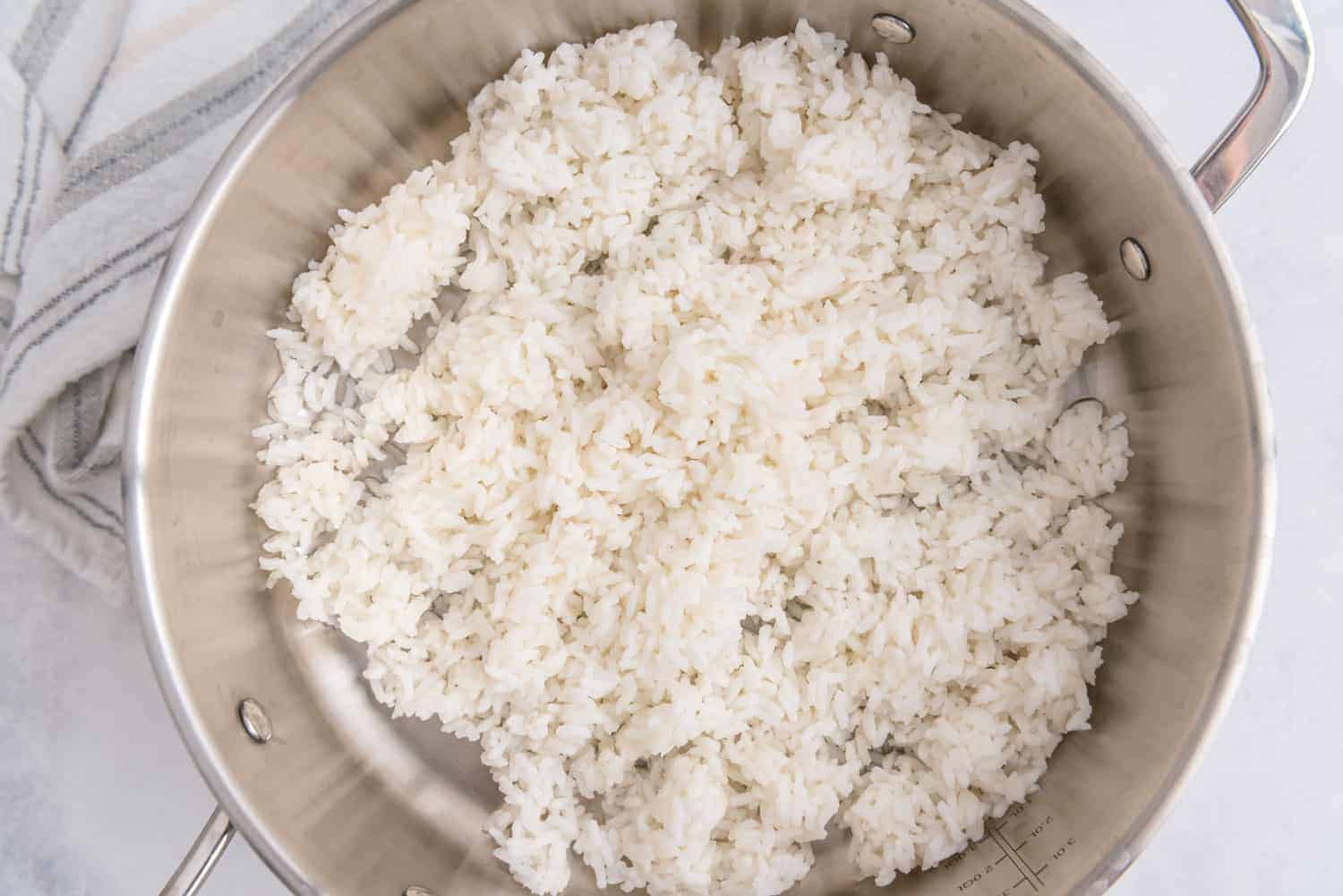 White rice in a stainless steel skillet.