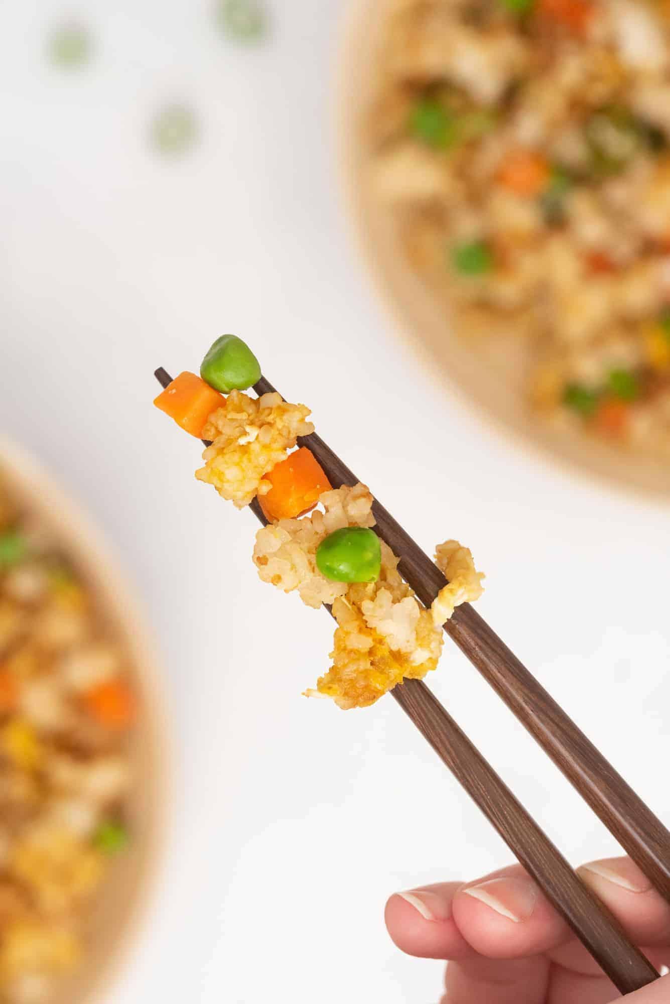 Rice between two chopsticks.