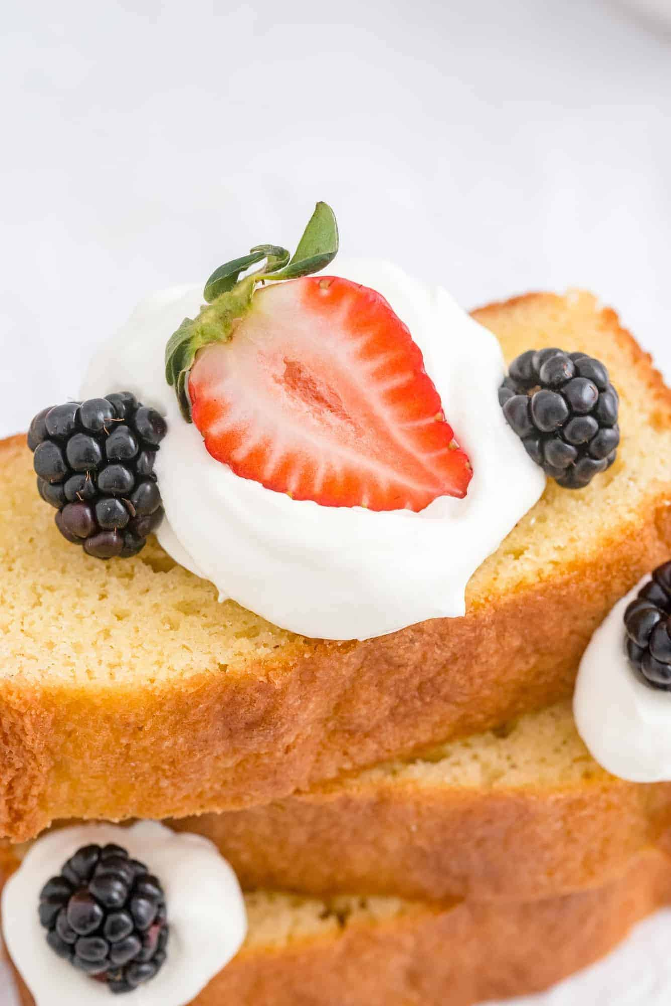 Cake slices with berries and whipped cream.