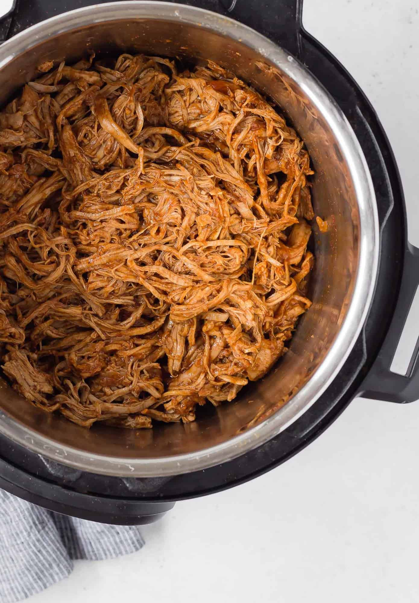 Instant pot Pulled pork in the instant pot, taken from overhead.