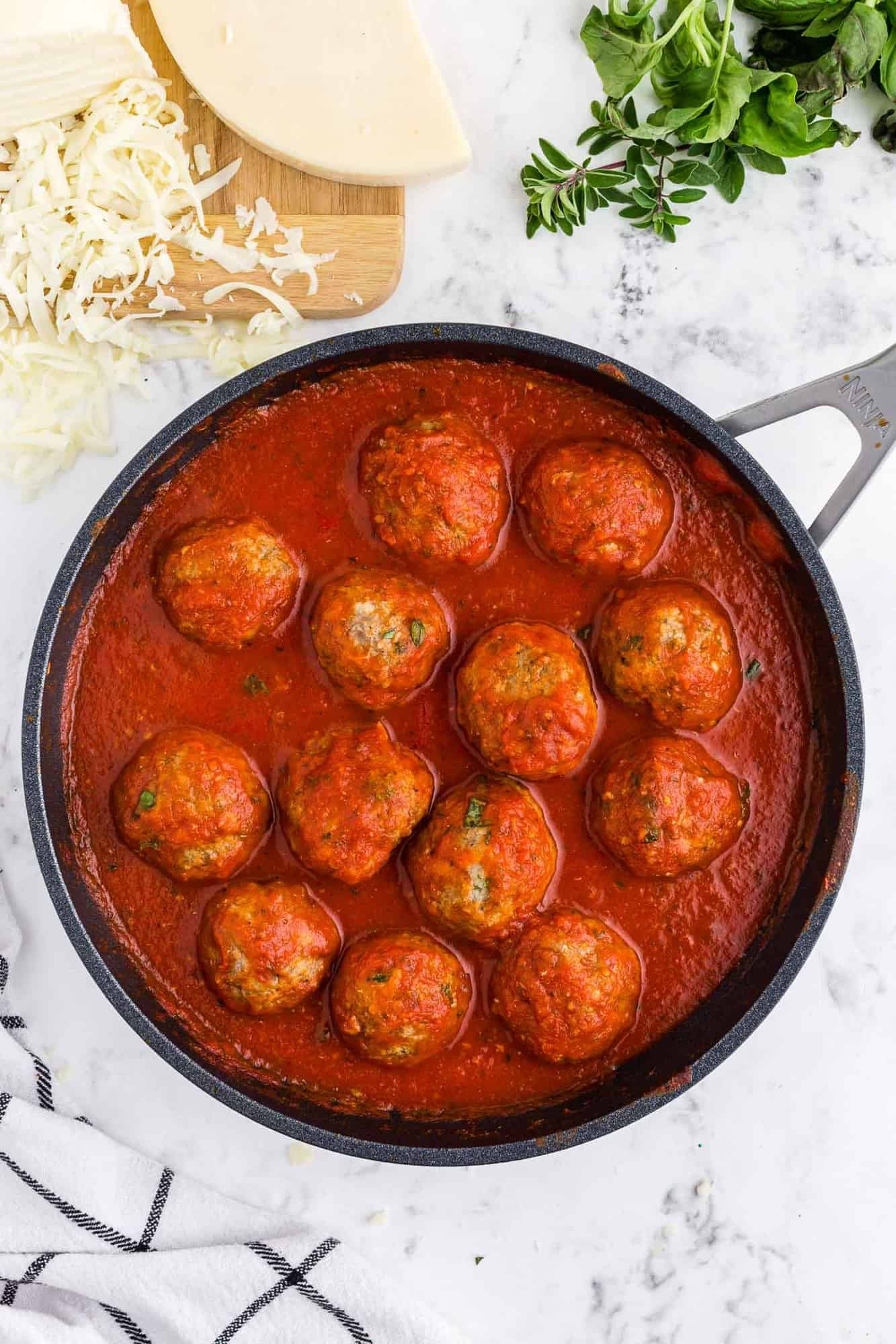 Meatballs and sauce in a pan.