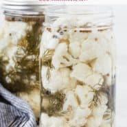 "Cauliflower in a jar, text overlay reads ""pickled cauliflower, rachelcooks.com"""