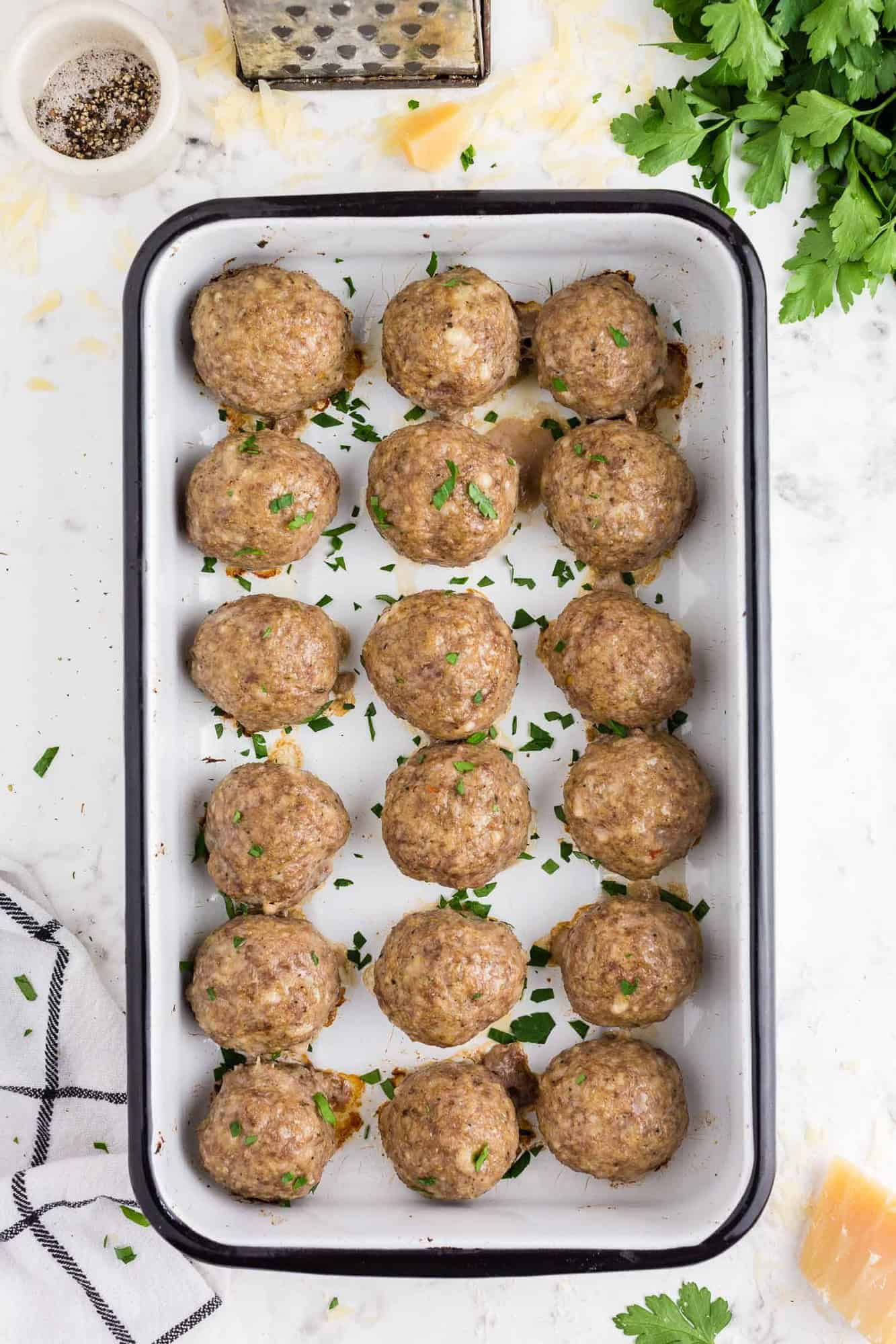 Cooked meatballs in a baking dish.