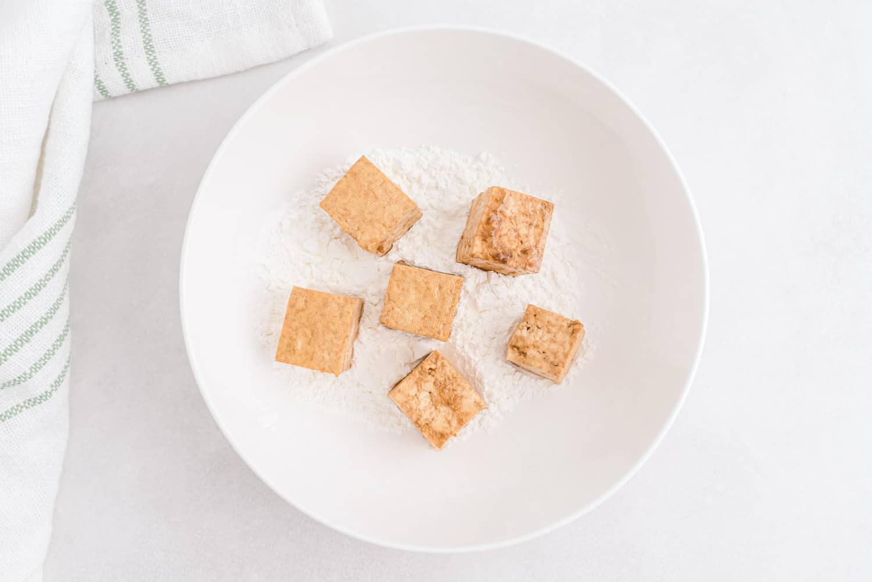 Tofu tossed with cornstarch.