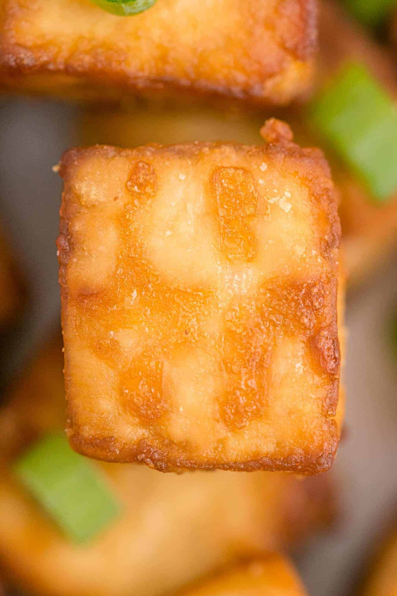 Very close up view of crispy cooked tofu.