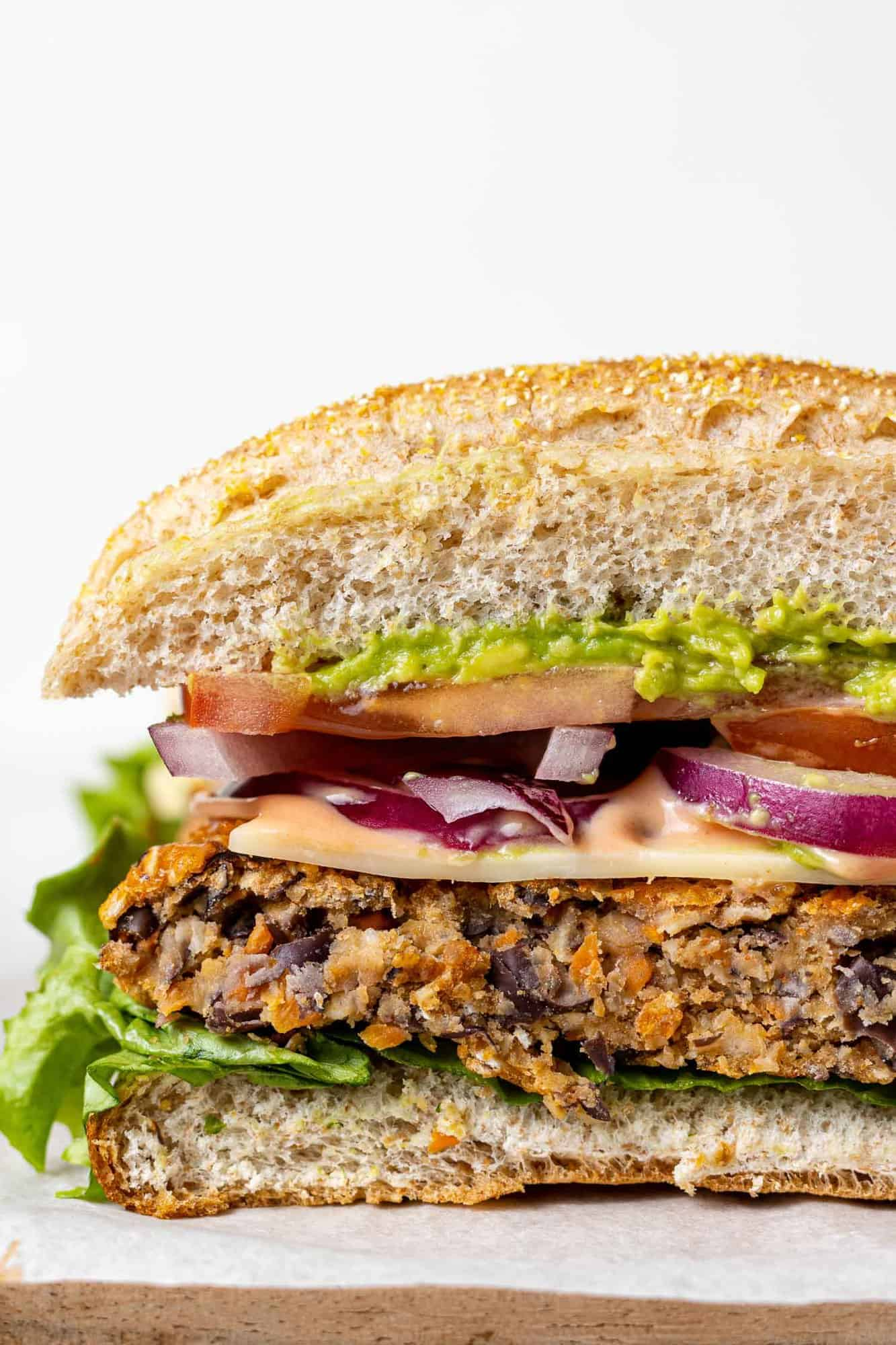 Bean burger with toppings, cut to show texture.