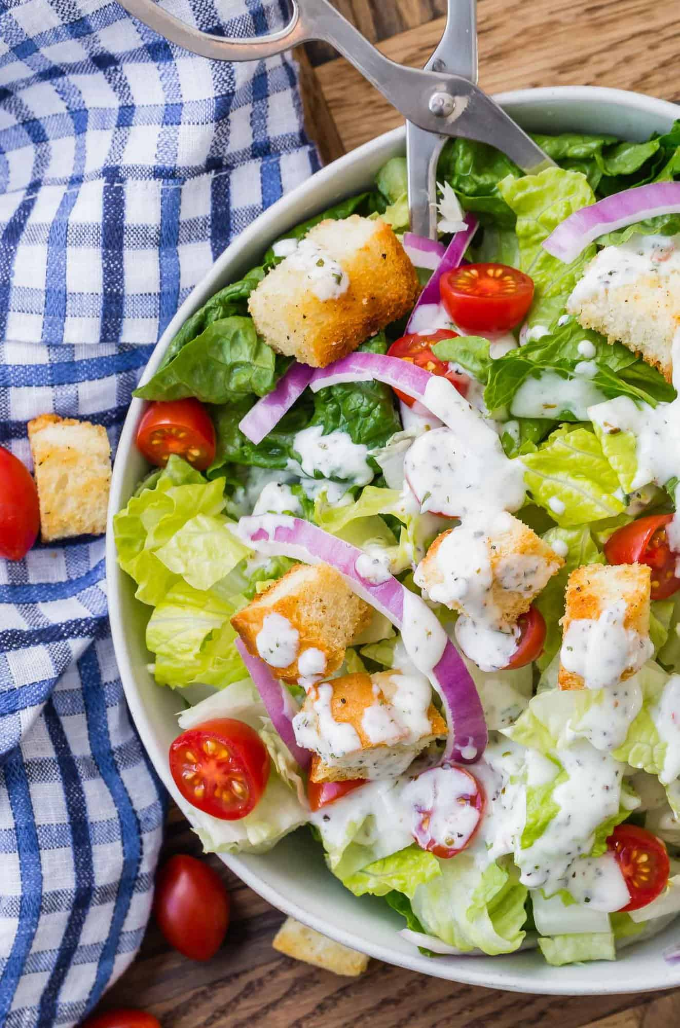 Tossed green salad with creamy white dressing.