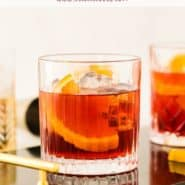 """Dark red cocktail with an orange in it, text overlay reads """"how to make the perfect negroni, rachelcooks.com"""""""