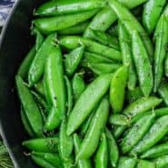 """Bright green peas, text overlay reads """"how to make sauteed sugar snap peas"""""""