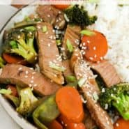 "Beef and vegetables in a bowl, text overlay reads ""easy sesame beef - perfect weeknight meal! rachelcooks.com"""