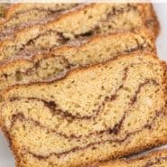 "Bread with cinnamon swirl, text overlay reads ""homemade snickerdoodle bread, rachelcooks.com"""