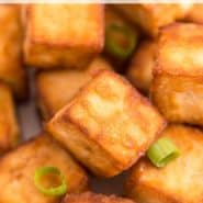 "Tofu and chopsticks, text overlay reads ""air fryer crispy tofu, rachelcooks.com"""