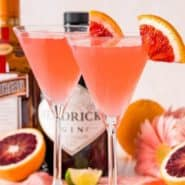 """Two light pink cocktails, text overlay reads """"blood orange martinis, rachelcooks.com"""""""