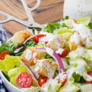 """Tossed salad with white dressing, text overlay reads """"easy creamy italian dressing, rachelcooks.com"""""""