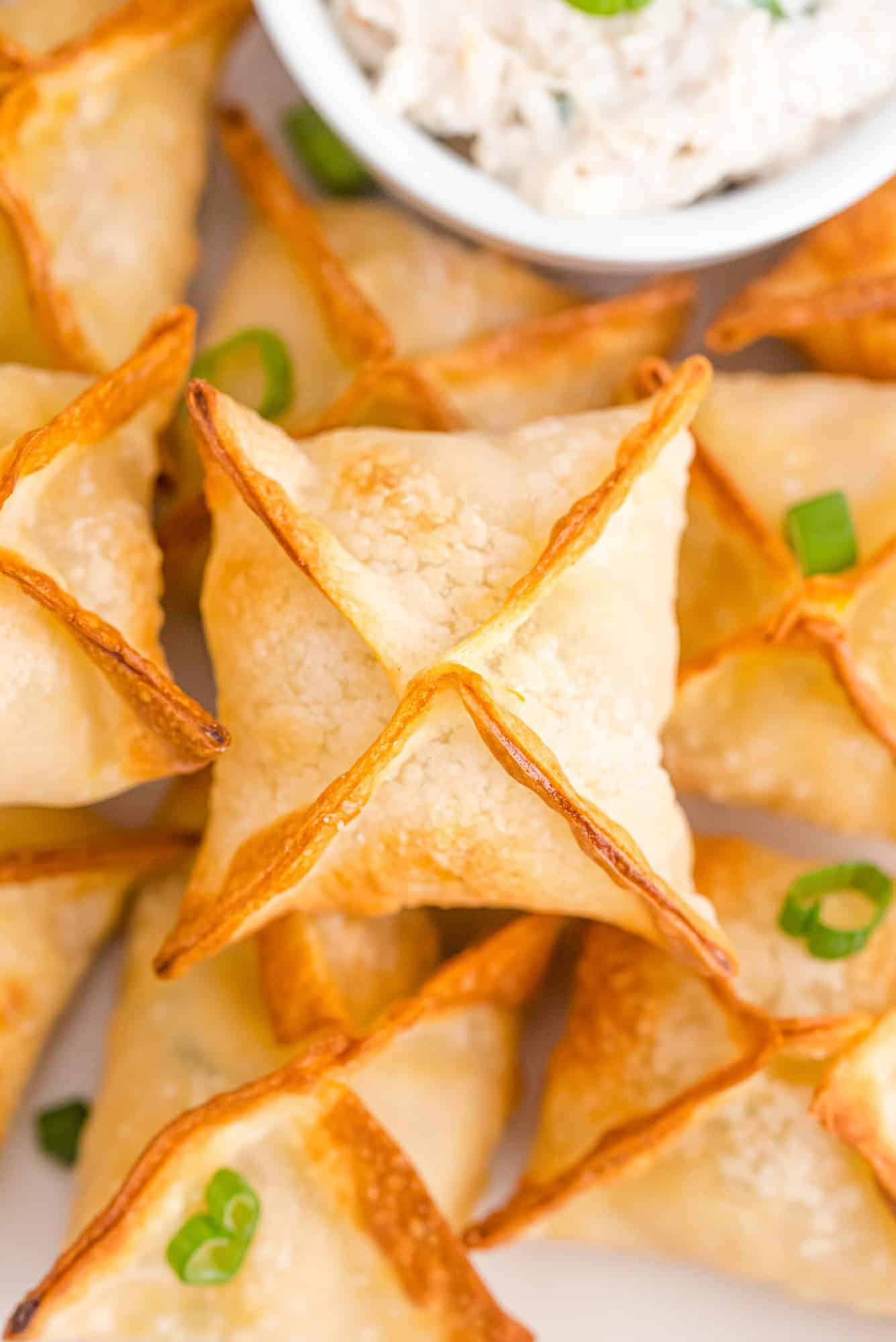 Stack of air fryer crab rangoon on a plate.