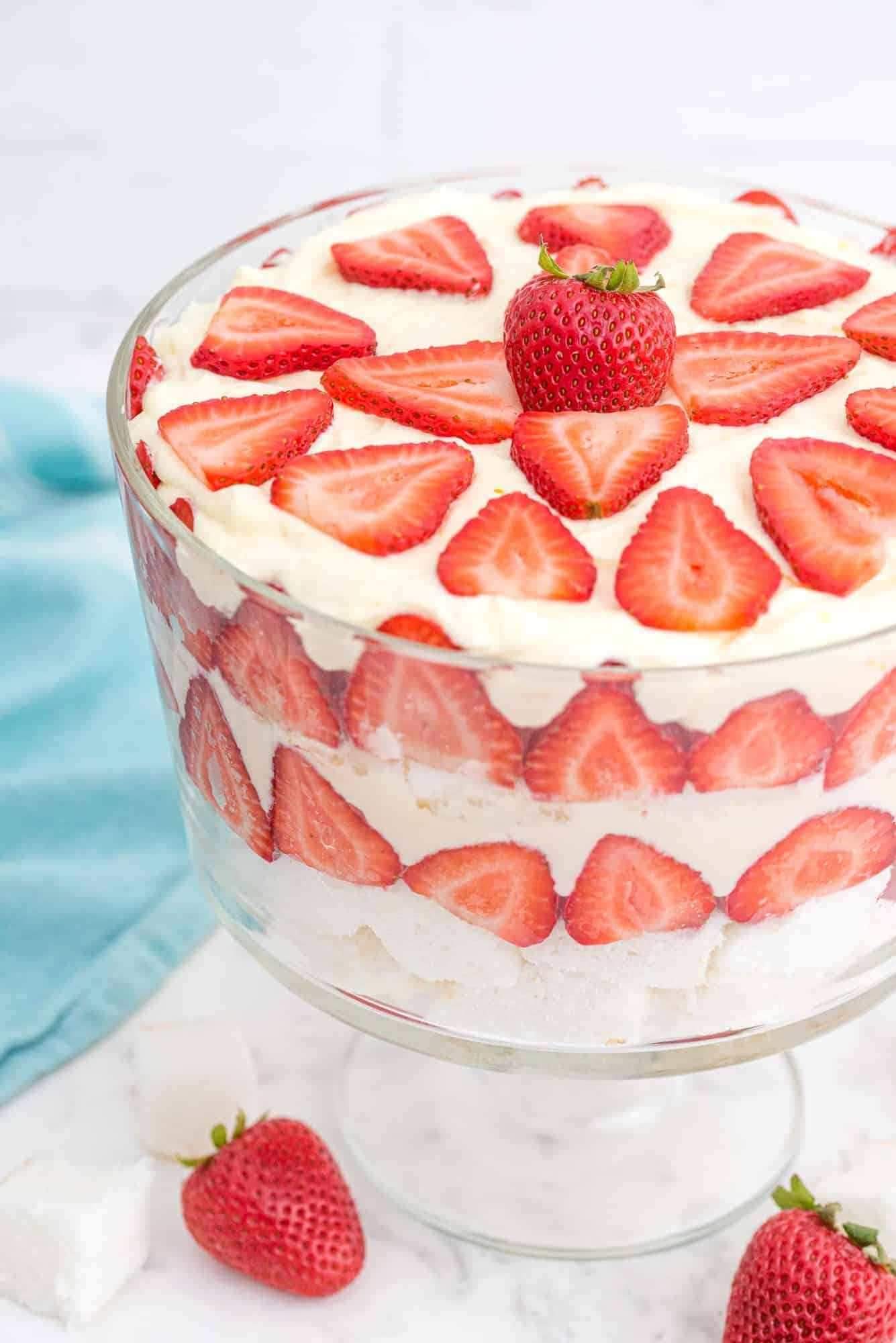 Trifle made with layers of strawberries, angel food cake, and pudding whipped cream mixture.