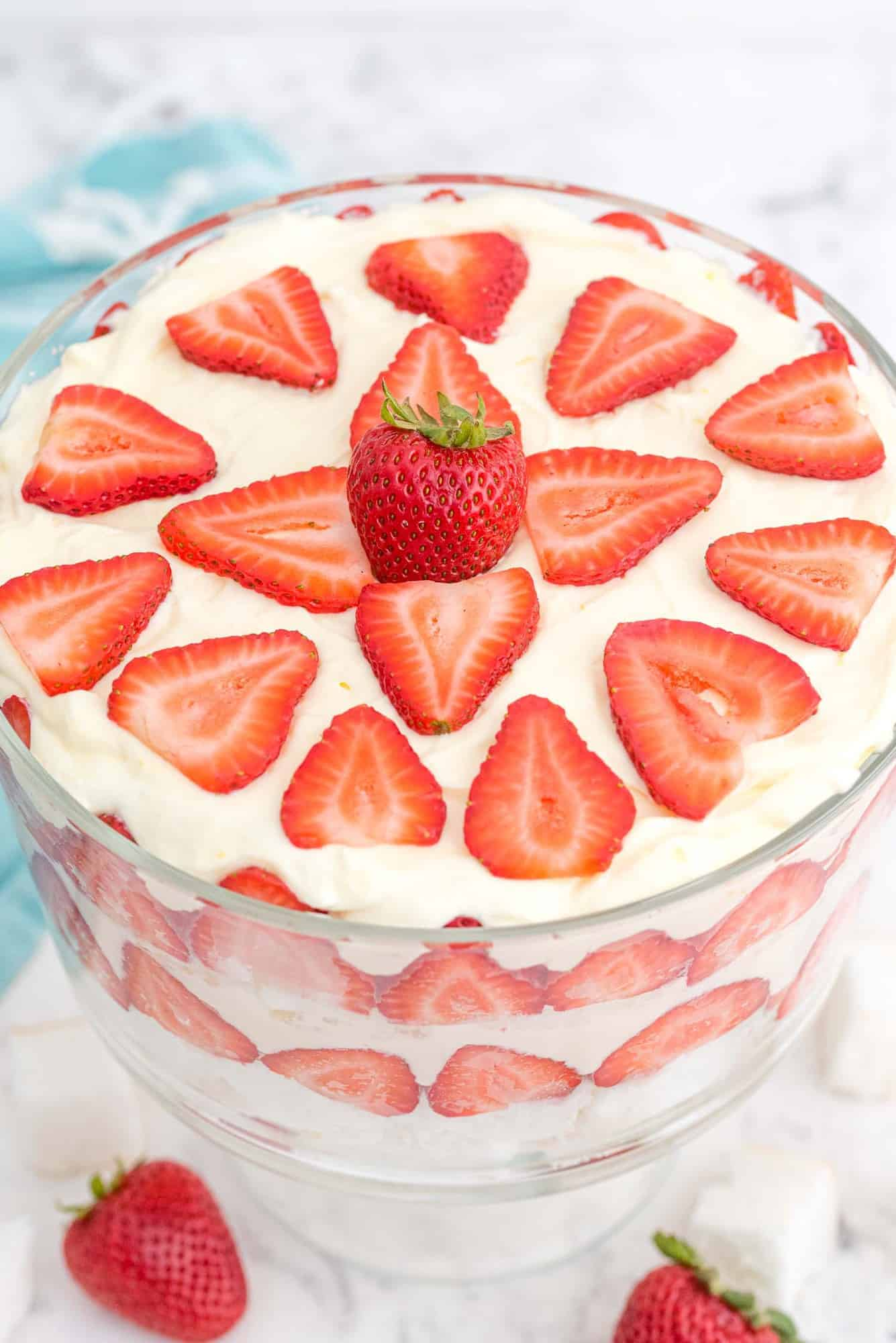 Trifle, decoratively topped with strawberries, viewed from above.