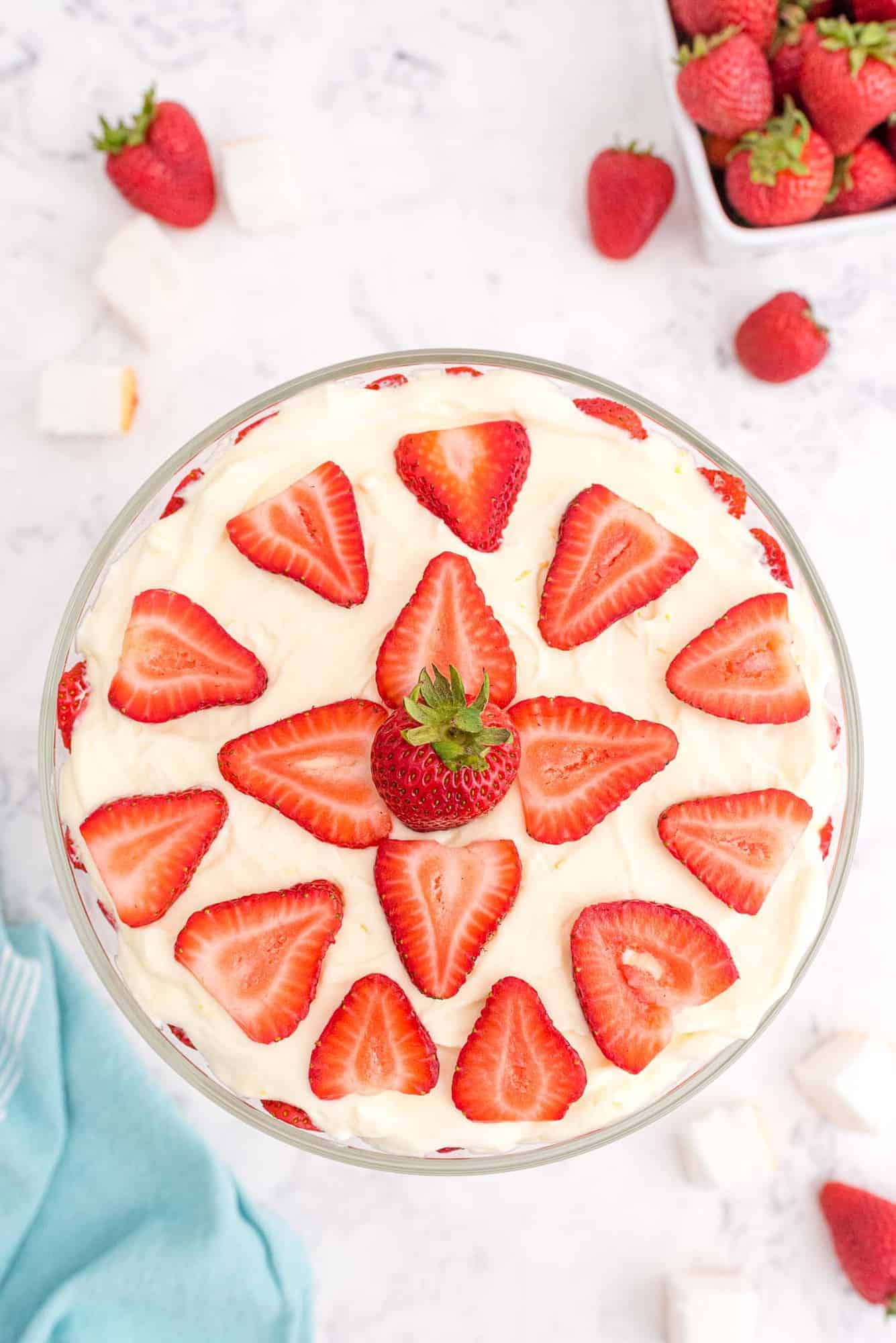 Strawberry dessert viewed from above, topped decoratively with slices of strawberries.
