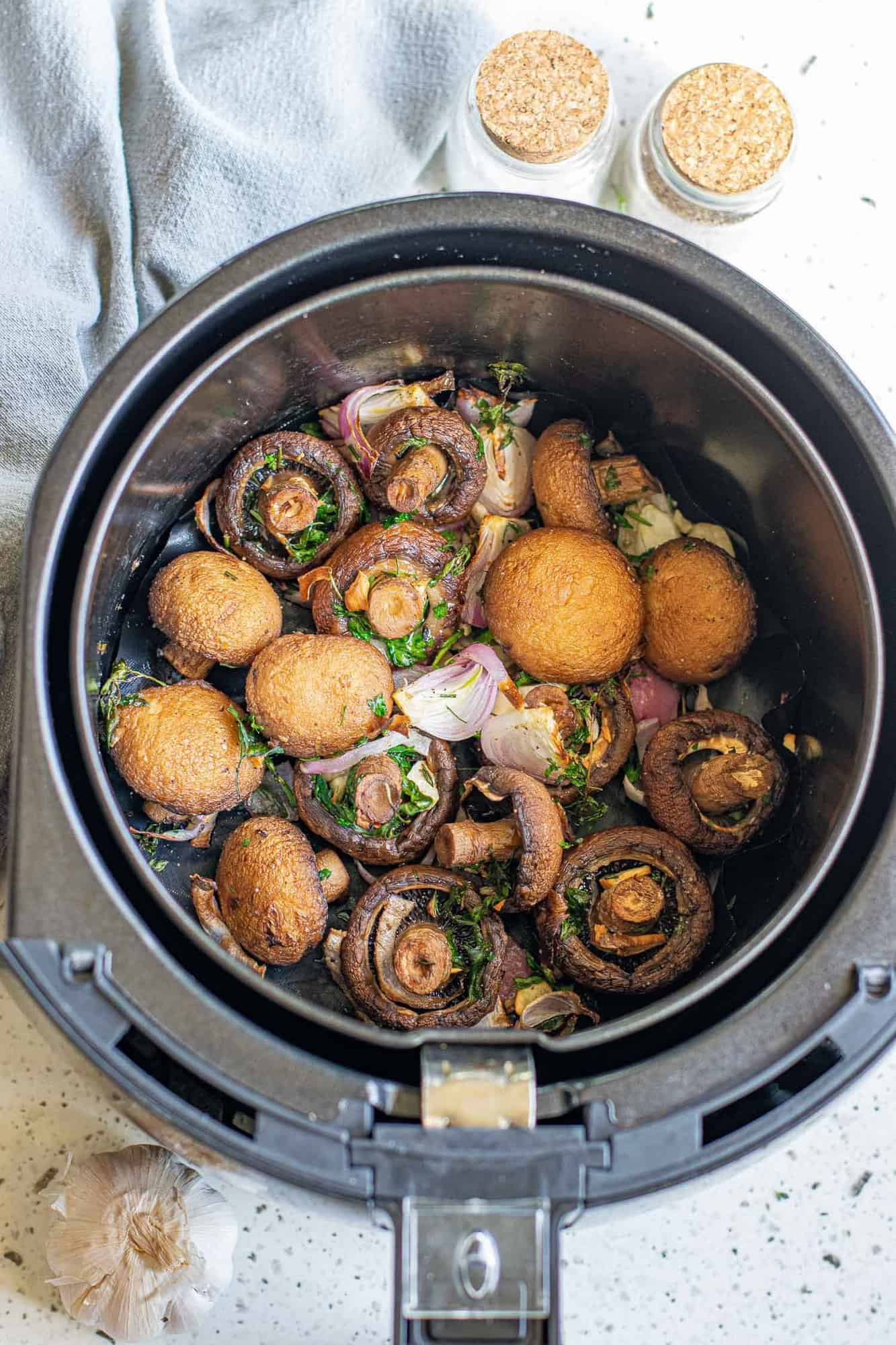 Cooked mushrooms in an air fryer.