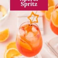 """An orange drink in a wine glass, with a text overlay that reads """"the best aperol spritz."""""""