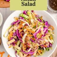"""Salad in white bowl, text overlay reads """"crunchy asian salad."""""""