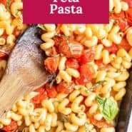"""Pasta in a baking dish, text overlay reads """"baked feta pasta."""""""