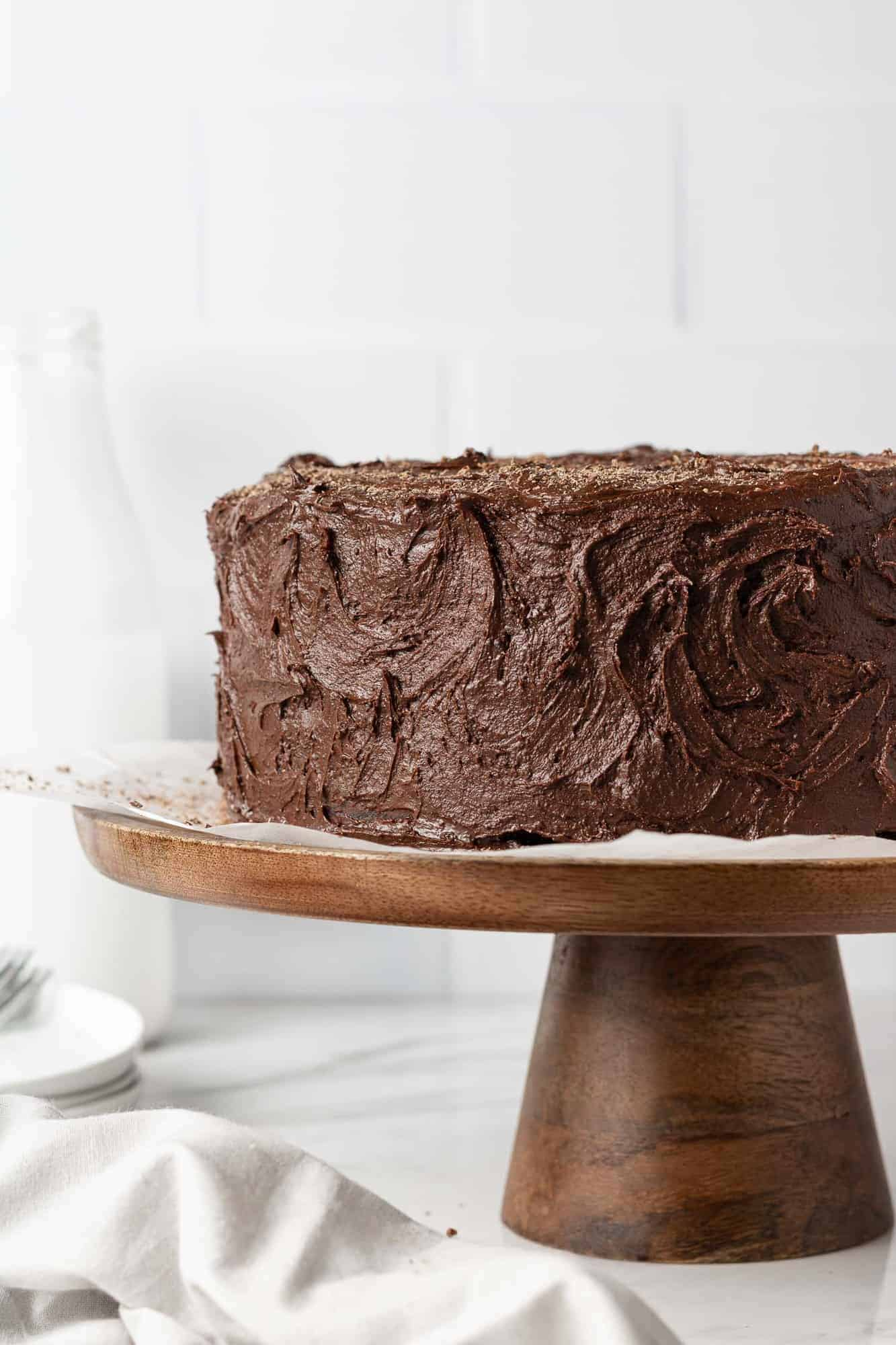 Chocolate layer cake on a cake stand.
