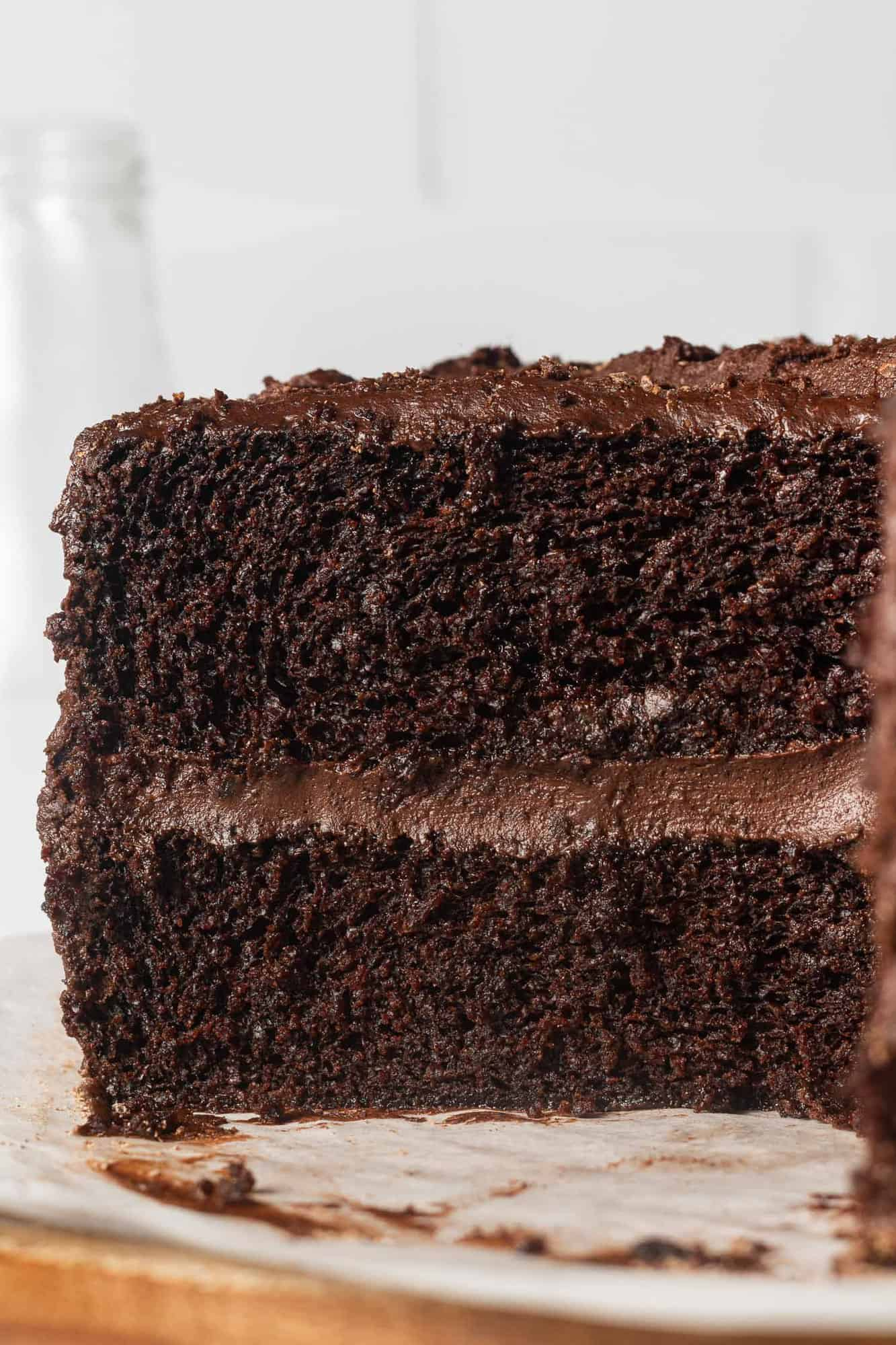 Chocolate layer cake, sliced, frosted with chocolate frosting.