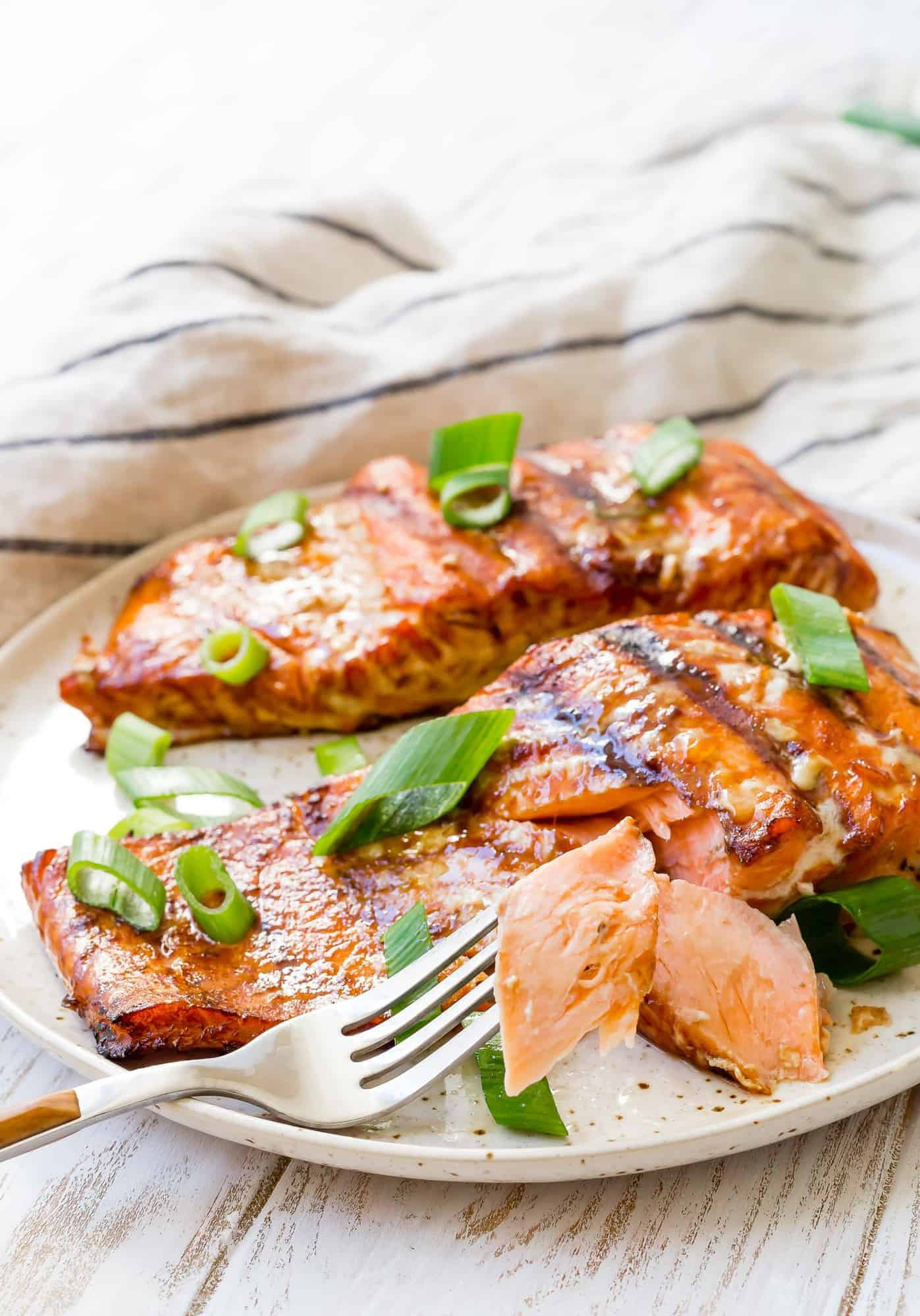 Salmon flaked with a fork to show texture.