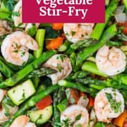 """Shrimp and vegetables in a frying pan, text overlay reads """"easy shrimp & vegetable stir-fry."""""""