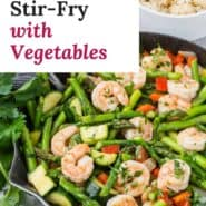 """Shrimp and vegetables in a frying pan, text overlay reads """"easy shrimp stir-fry with vegetables."""""""