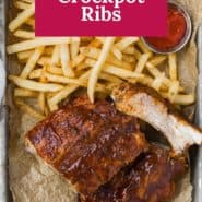 """Ribs on tray with fries, text overlay reads """"the best crockpot ribs."""""""