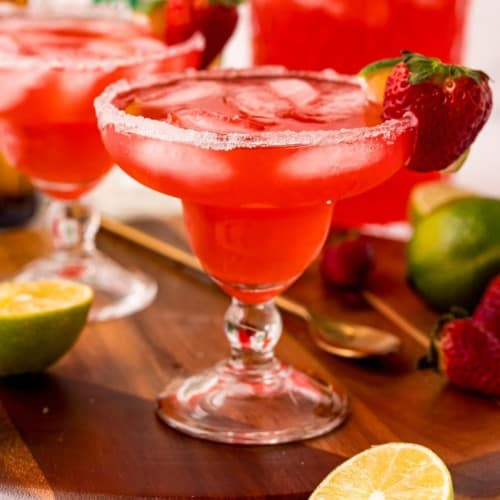 Red iced beverage in a margarita glass.