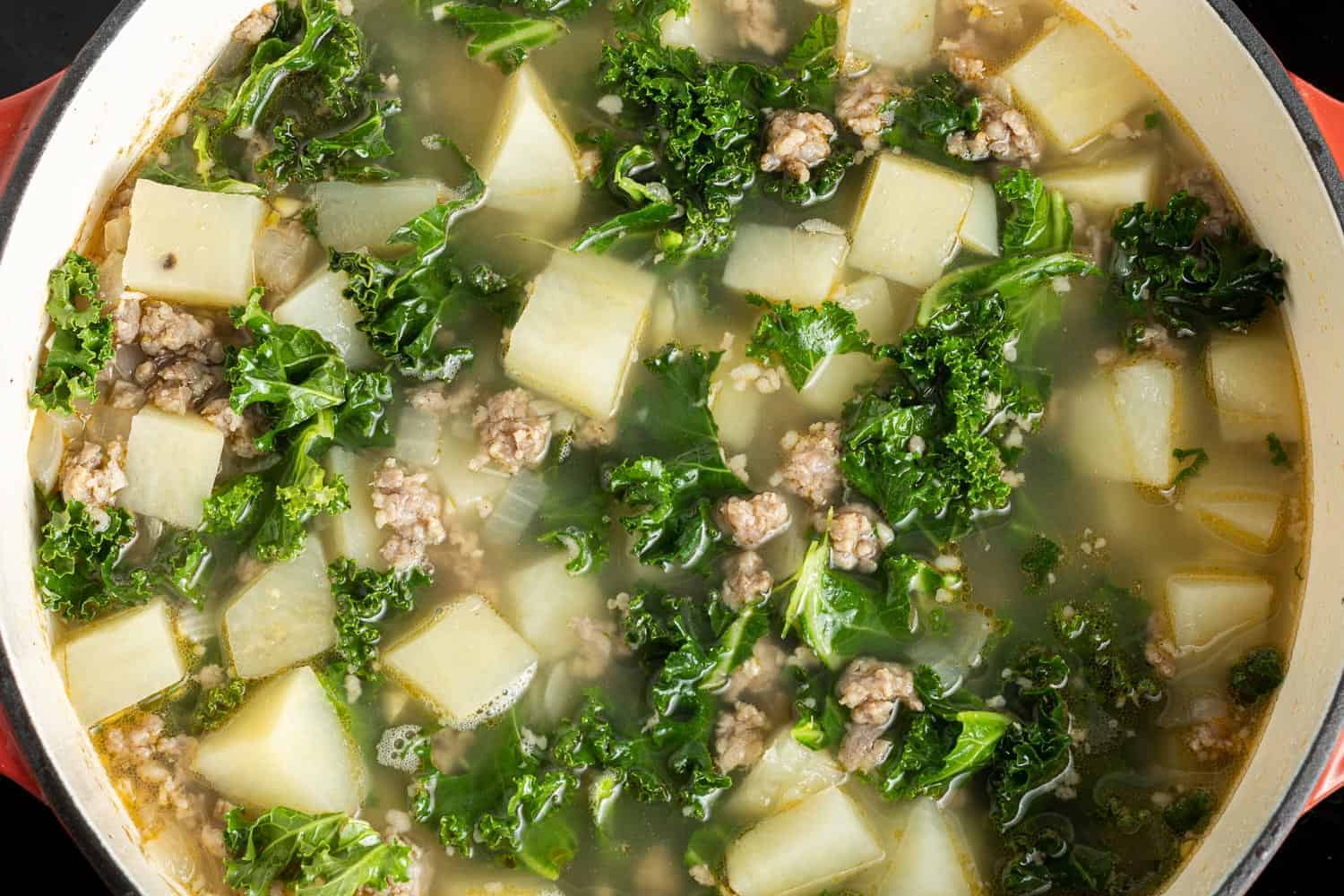 Kale, sausage, and potatoes in the broth.