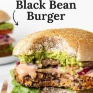 "Close up of a vegetarian burger, text overlay reads ""the best black bean burger."""