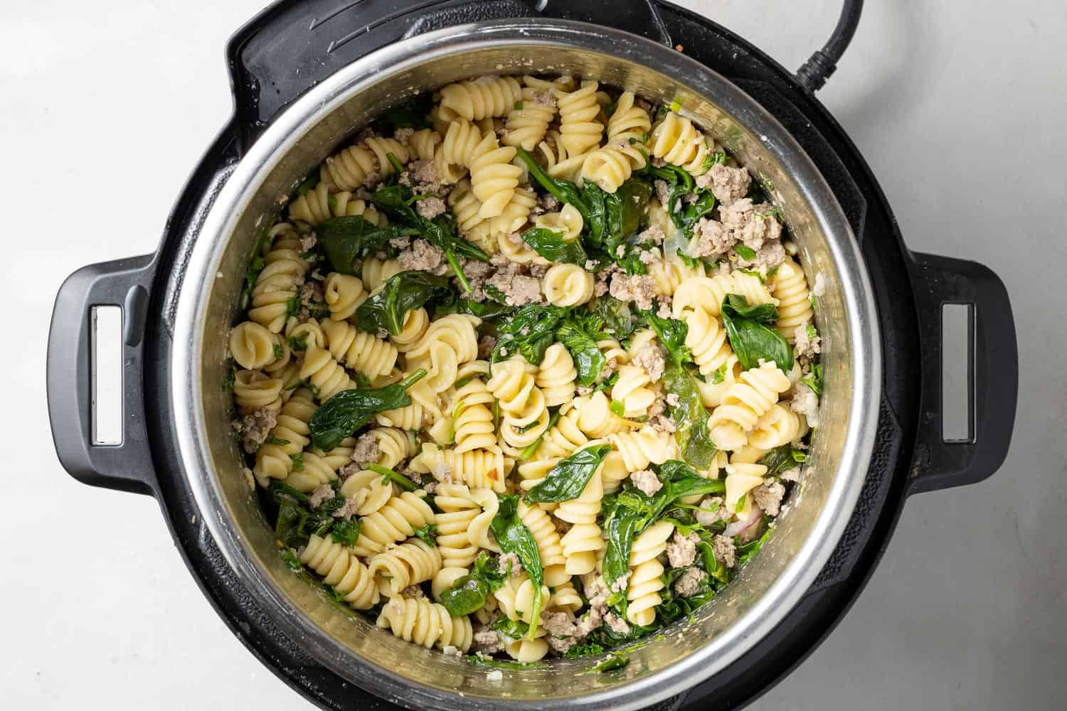 Instant pot pasta with lemon and chicken, still in instant pot.