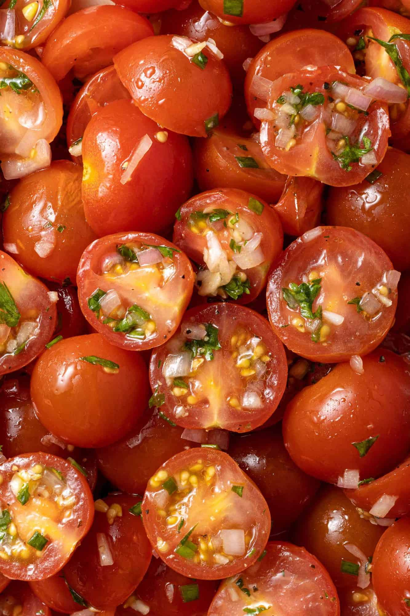 Close up of marinated tomatoes, filling image.