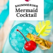 """Two festive blue cocktails, text overlay reads """"mermaid cocktail."""""""