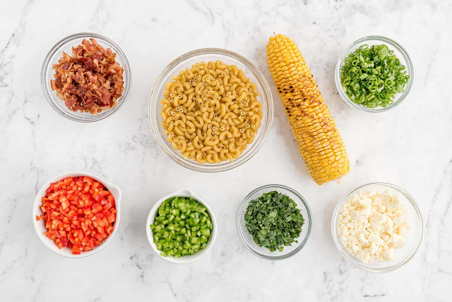 Overhead view of ingredients needed for salad.