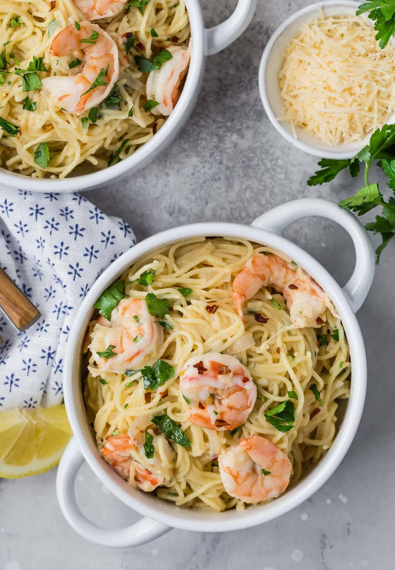 Overhead view of two bowls of shrimp pasta.