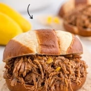 """Pulled pork with text overlay that reads """"mango bourbon pulled pork."""""""