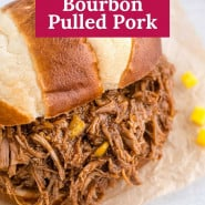 """Pulled pork with text overlay that reads """"crockpot mango bourbon pulled pork."""""""