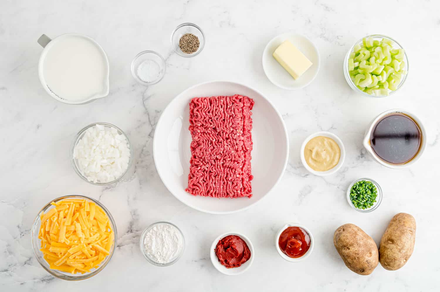 Overhead view of ingredients needed for recipe, all in separate white and clear bowls.