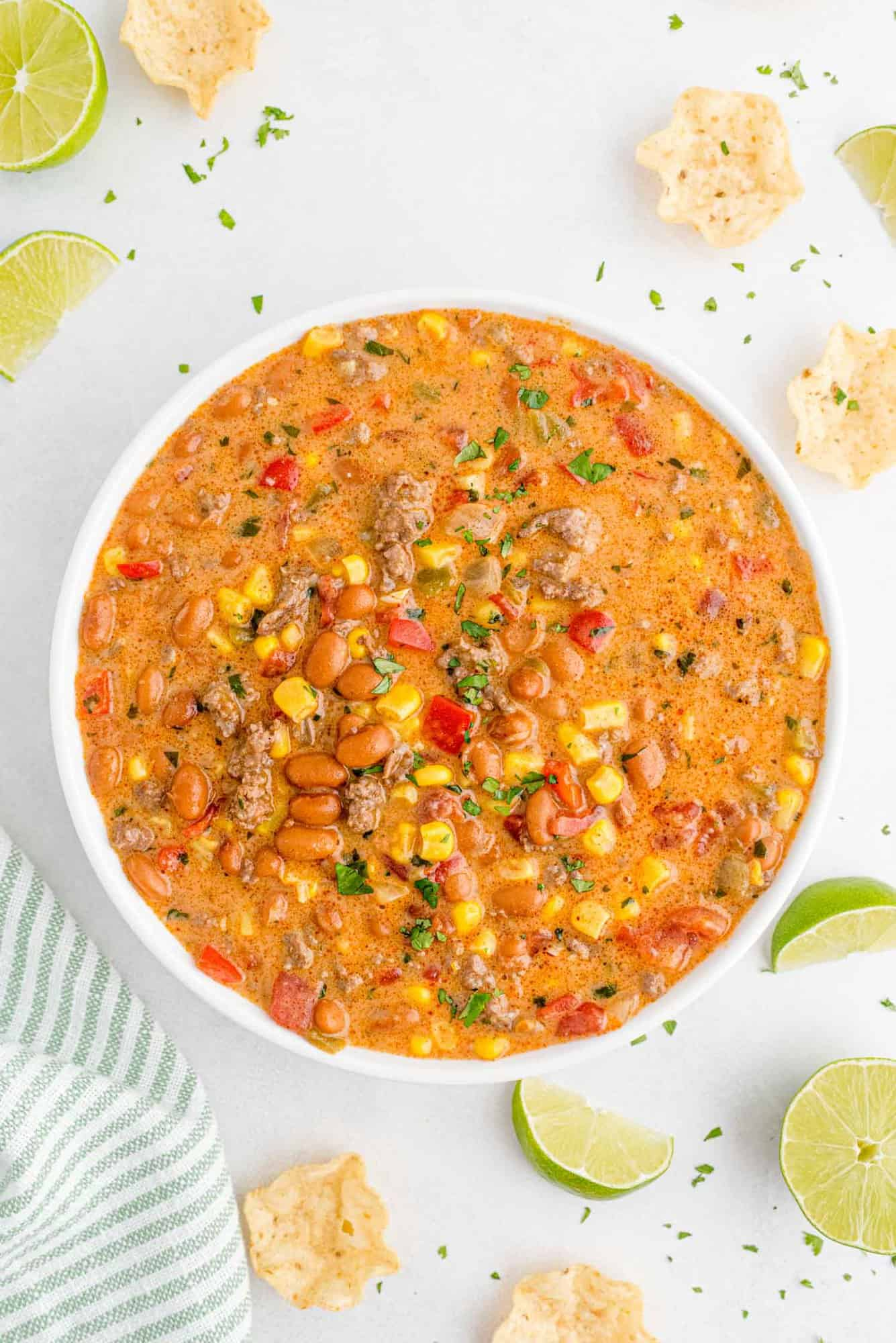 Overhead view of a large bowl of creamy chili topped with cilantro.