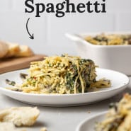 """Spaghetti with a text overlay that reads """"the best baked spaghetti."""""""