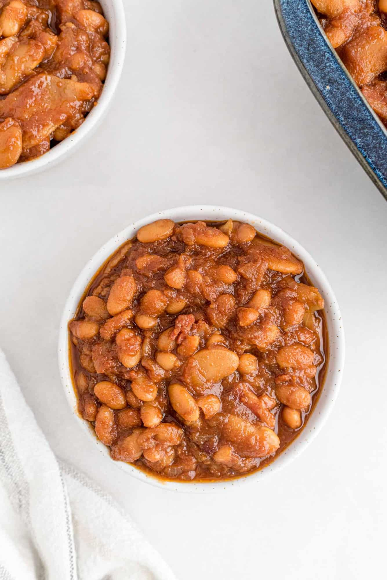 Baked beans in a small white bowl.