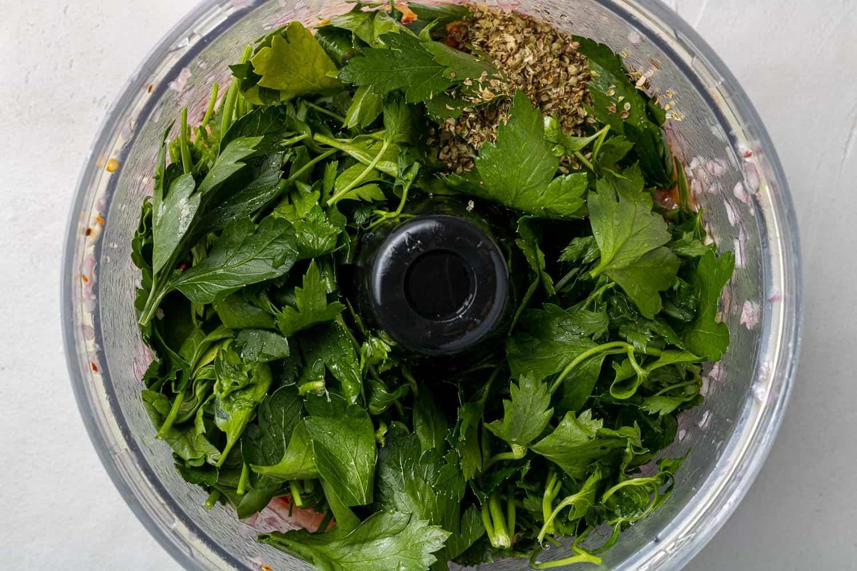 Fresh parsley in a food processor.