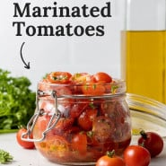 """Tomatoes in a jar, text overlay reads """"the best marinated tomatoes."""""""