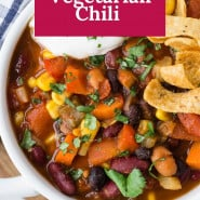 """Chili in a bowl, text overlay reads """"the best vegetarian chili."""""""