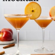 """Brown drink in martini glass, text overlay reads """"apple cider mocktail."""""""
